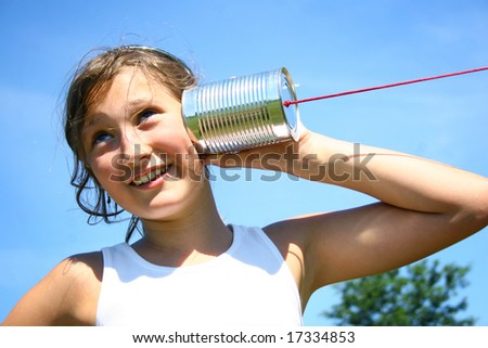 Young girl talking with metal phone