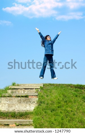 Young girl teenager jumping from joy