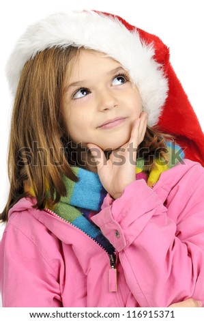 Young girl thinking about presents with Santa's red hat