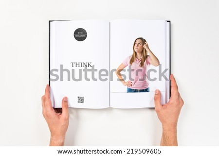 Young girl thinking printed on book #219509605