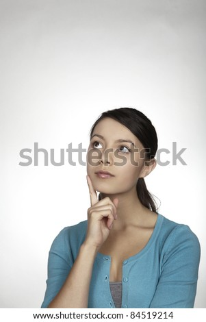 young girl thinking something over - stock photo