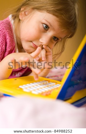 young girl thinks before laptops
