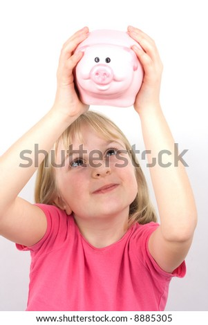 Young girl trying to get money out of a piggy bank