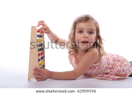 Young girl using abacus confidently