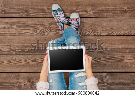 Young girl using white tablet
