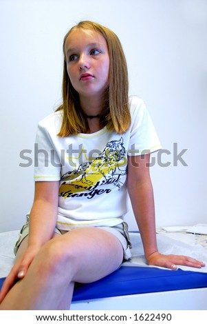 Young girl waiting in doctor's office