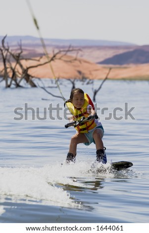 Young girl wakeboarding at Lake Powell, Glen Canyon National Recreation Area Utah USA