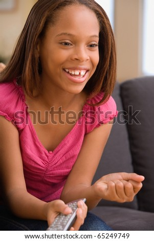 Young girl watching television