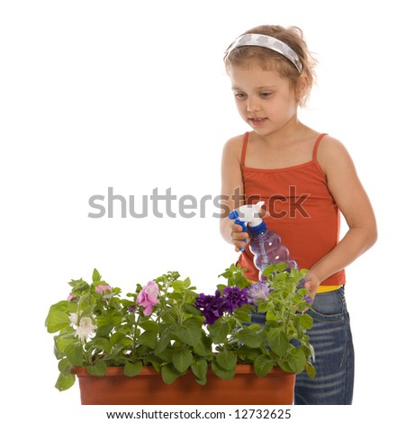 Young girl watering a flower in flowerpot