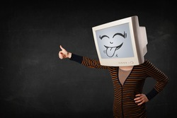 Young girl wearing a monitor with a funny face gesture