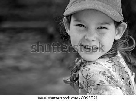 Young Girl Wearing Ball Cap