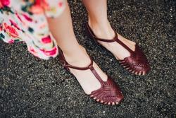 Young girl wearing fashion t-bar sandals