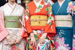 Young girl wearing Japanese kimono standing in front of Sensoji Temple in Tokyo, Japan. Kimono is a Japanese traditional garment. The word