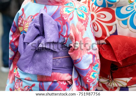 """Young girl wearing Japanese kimono standing in front of Sensoji Temple in Tokyo, Japan. Kimono is a Japanese traditional garment. The word """"kimono"""", which actually means a """"thing to wear""""  #751987756"""