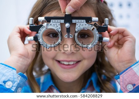 Young girl wearing trial fame in ophthalmology clinic