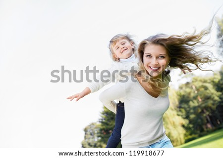 Young girl with a baby in the park