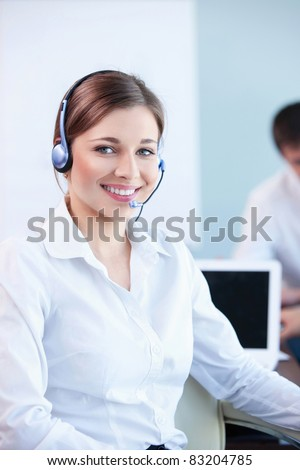 Young girl with a call center in the office