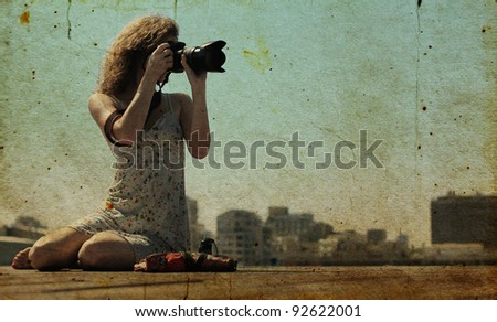 young girl with a camera.  Photo in old color image style.