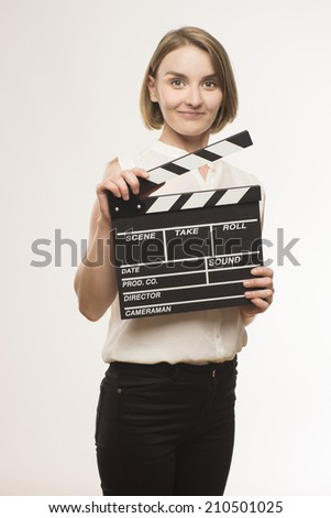 young girl with a clapperboard cinema #210501025