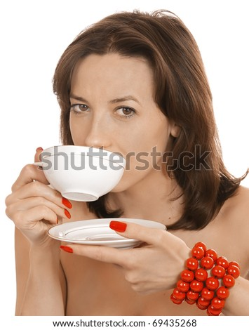 Young girl with a cup of tea and a red beads