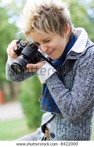 Young girl with a digital camera