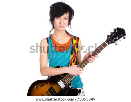 Young girl with a guitar on a white background