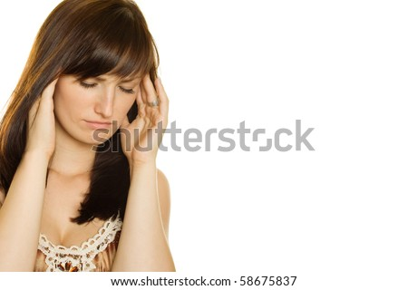 Young girl with a headache on white background
