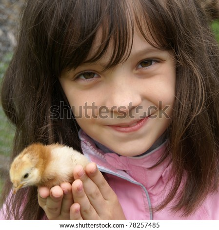 Young girl with a little chicken - stock photo