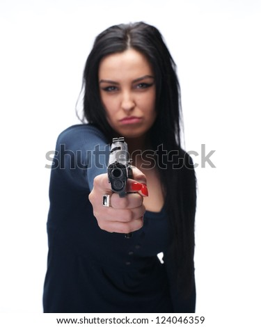 Young girl with a pistol on a white background