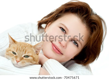 Young girl with a red cat