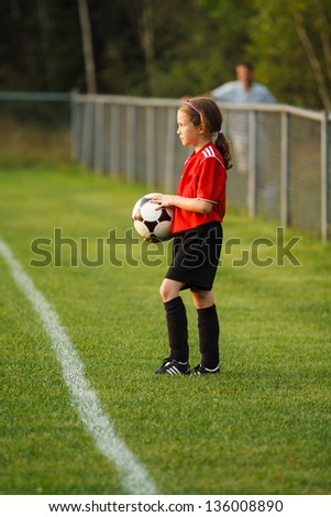 Young girl with a soccer ball