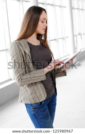 young girl with a tablet in office - stock photo
