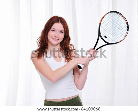 Young girl with a tennis racket on a white background
