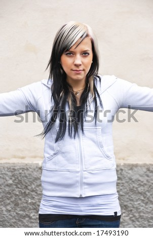 young girl with arms spread around