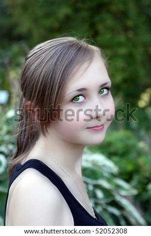 young girl with beautiful green eyes