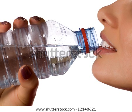 young girl with bottle of mineral water (isolated on white)