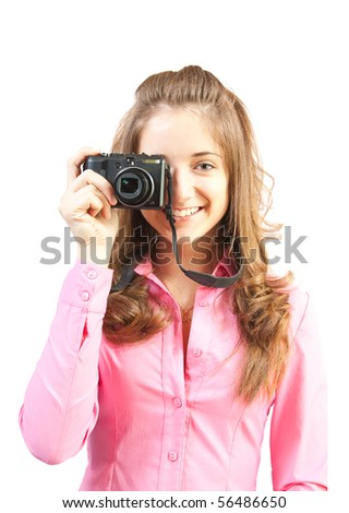 Young girl with camera isolated over white