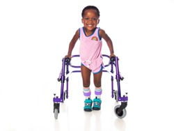 Young girl with cerebral palsy taking steps with her walker