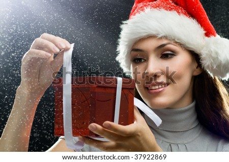 young girl with christmas present in hands