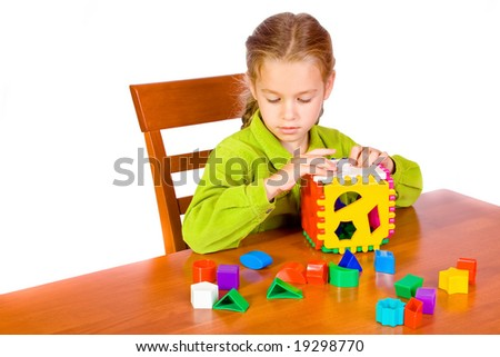 Young girl with cube