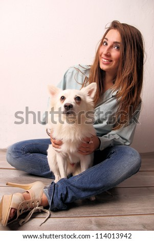 Young girl with cute dog, studio shot