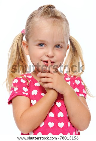 stock photo young girl with finger on lips gestures to be quiet