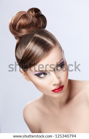 Young girl with hair and makeup on white background