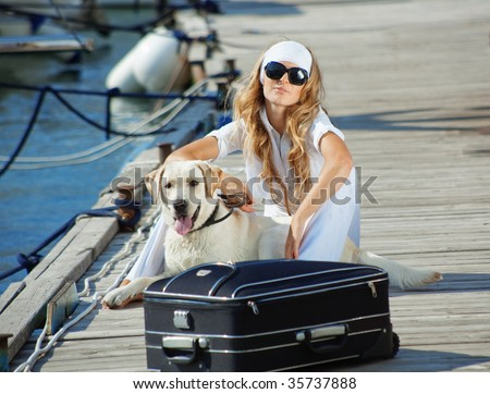 Young girl with her dog going on voyage