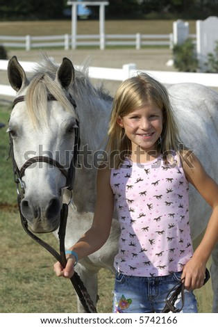 Young girl with her pony at horse show.