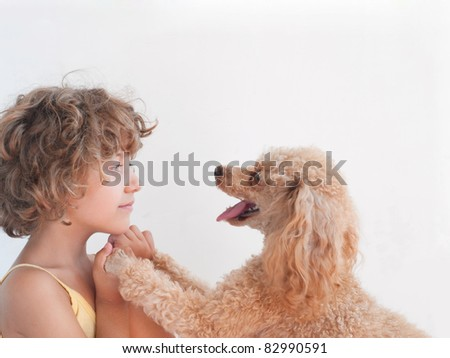 Young girl with her toy Poodle