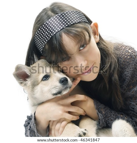 Young girl with little dog over white background