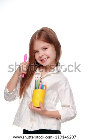 Young girl with lots of pencils smiling happily - isolated/Joyful little girl with pencils