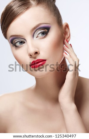 Young girl with makeup on white background