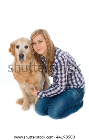 Young girl with pet dog isolated on white
